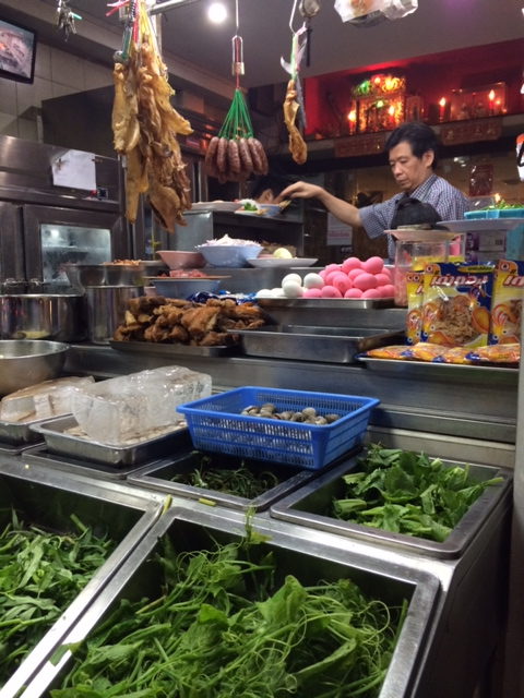 Sangchai's shopfront with your choice of seasonal proteins and greens