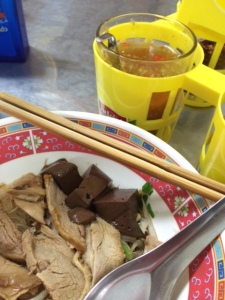 Duck noodles with the condiment tray at Guaythiew Ped on St. Louis Road